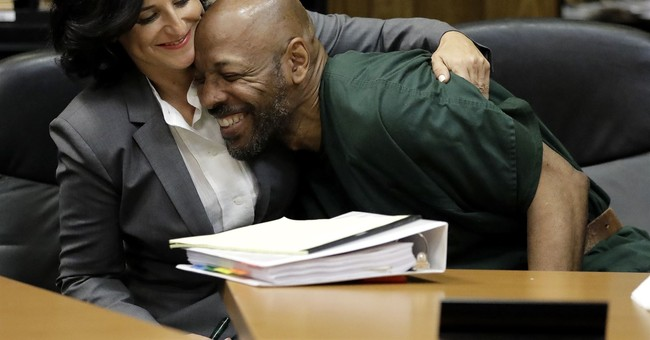 Men freed on bail after 24 years in prison in deadly robbery