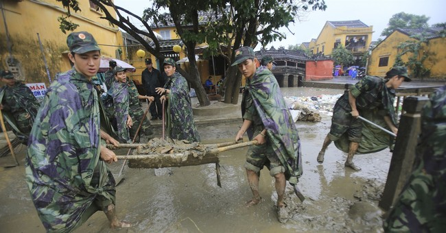 Troops, residents of Vietnam's Hoi An clean up from floods