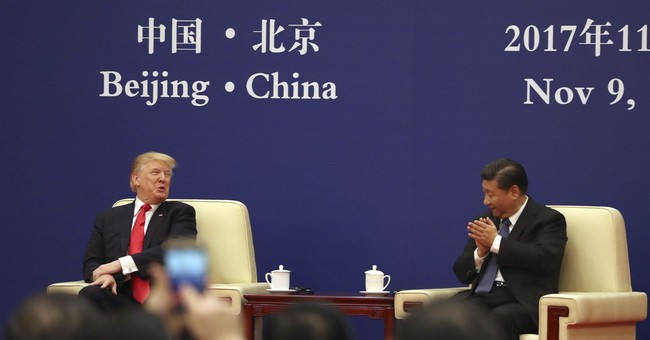 China, US sign more business deals during Trump visit
