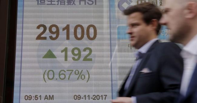 World shares mixed as investors watch Trump's China visit