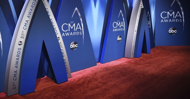 The Latest: Urban debuts new song at CMA Awards