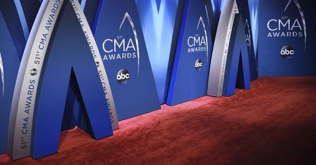 The Latest: Urban debuts new song at CMA Awards