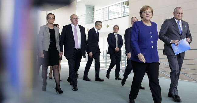 German gov't expects higher tax take, cautious on spending
