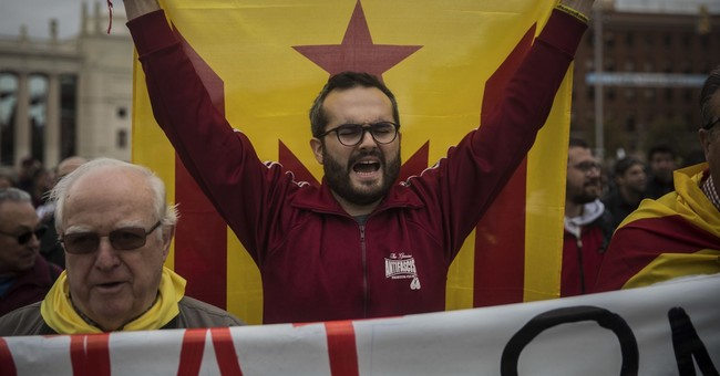 Catalonia strike is muted but protesters block roads, trains