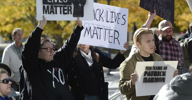 APNewsBreak: Board backs Utah officer in protested shooting
