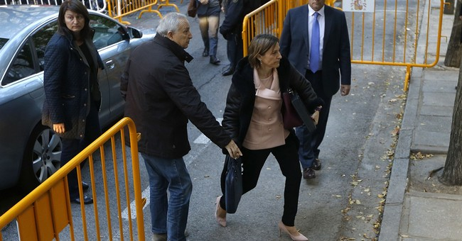 The Latest: Catalan parliament speaker leaves Spain prison