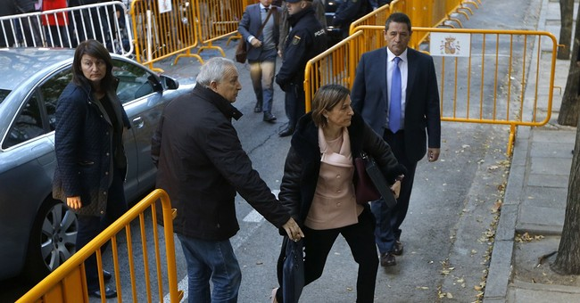 The Latest: Catalan parliament speaker leaves Spain prison