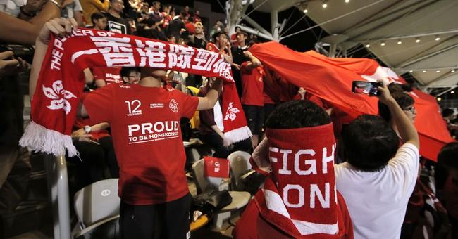 Defiant Hong Kong soccer fans boo China anthem at match