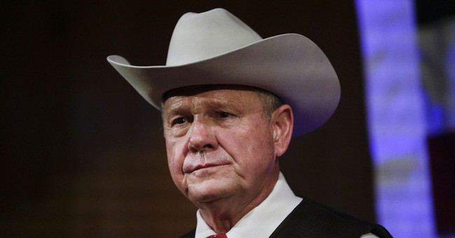 Bible scholars take issue with Moore's defender