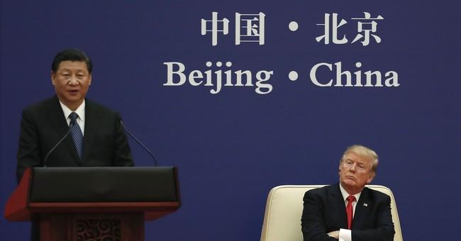The Latest: White House says no formal Trump-Putin meeting