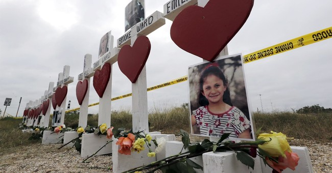 The Latest: Church shooter's dad says family is grieving