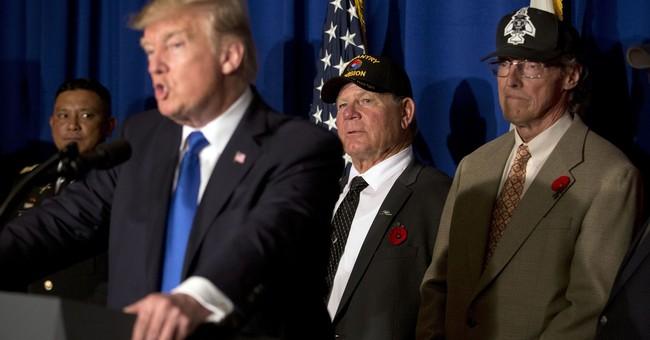 Trump marks Veterans Day in Vietnam