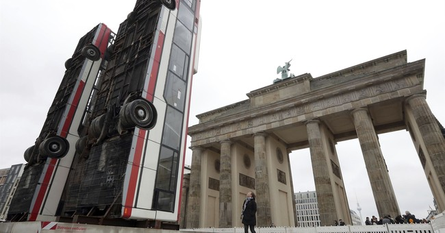 Buses upended in Berlin evoke suffering of Syrian refugees