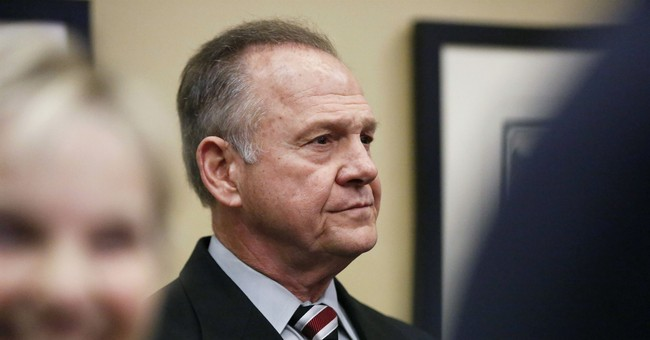Moore dismisses allegations in story, says lawsuit to come