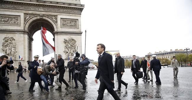 President Macron of France solemnly marks Armistice Day