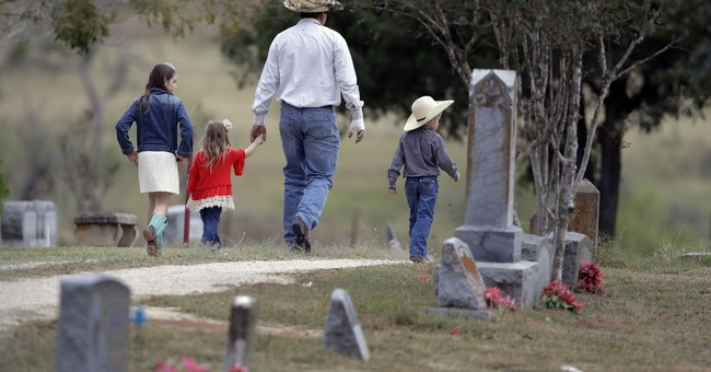 The Latest: 2 Texas church shooting victims buried