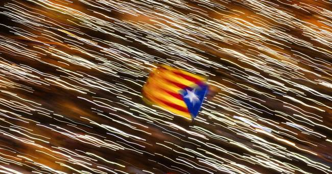 The Latest: Spain analyzing source of fake news on Catalonia