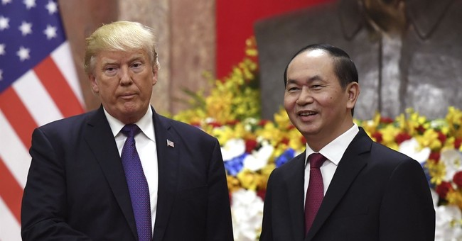 The Latest: Vietnam wants peaceful end to sea disputes