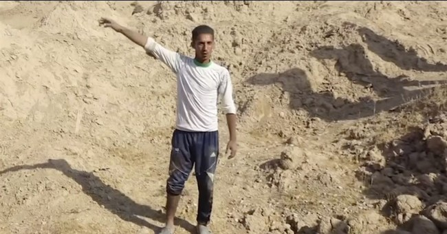 New mass graves found in Iraq could contain up to 400 bodies
