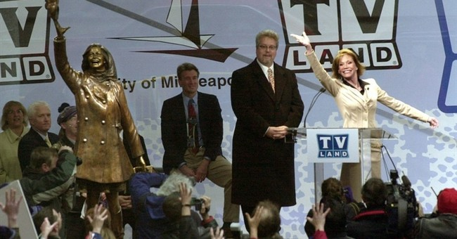 Hat-tossing Mary Tyler Moore statue back at Minneapolis site