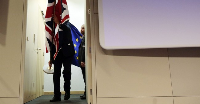 The Latest: UK Parliament to get vote on final Brexit deal