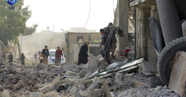 Activists: Airstrike on rebel-held Syrian town kills 53