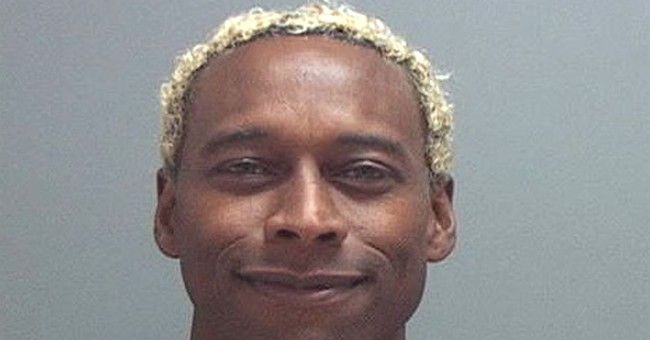 Ex-football player charged with murder in wife's death