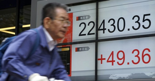 Nikkei up but Asia shares mostly lower, digesting China data