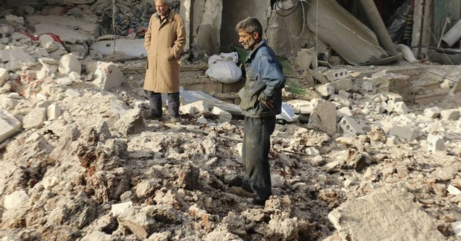 Activists: Airstrike on rebel-held Syrian town kills 53