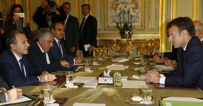 The Latest: Saudi FM says up to Hariri to decide to return