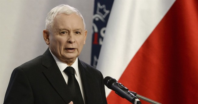 Leader says Poland has won its migration dispute with EU