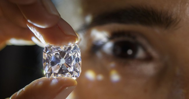 Giant diamond in necklace sells for $33.7M at Geneva auction