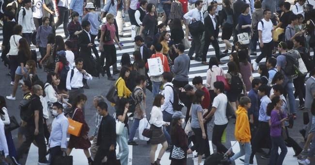 Japan exports drive expansion, offset weak consumer spending