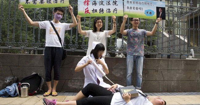 Rights group urges China to ban abusive gay 'conversion'