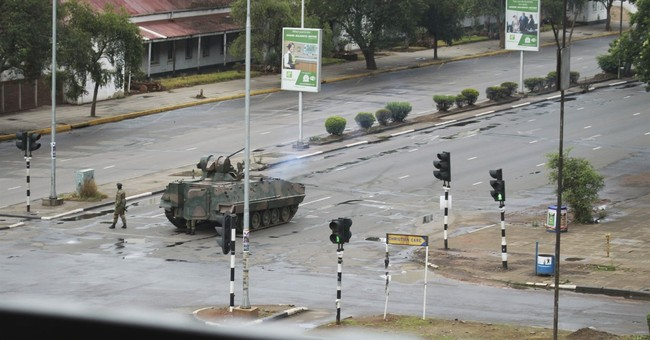 The Latest: Zimbabwe youth leader apologizes to army leaders