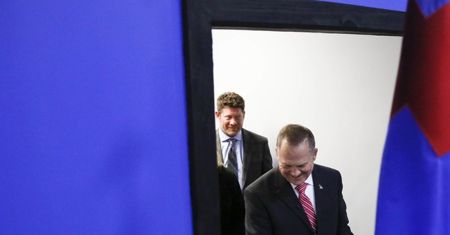 The Latest: Post editor: Call seeking dirt on Moore was fake