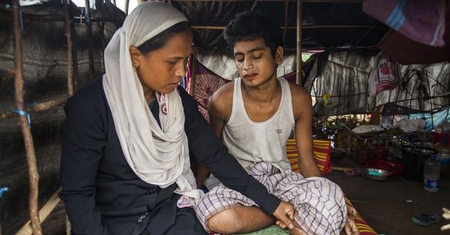 Rohingya woman in Bangladesh helps others flee Myanmar