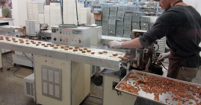 Survey: New York factories grow at slower pace in November