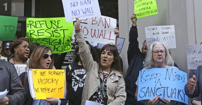 The Latest: Vatican expands criticism of Trump's travel ban