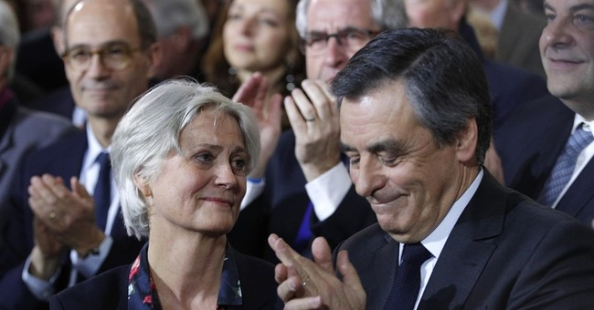 The Latest: Children of France's Fillon included in probe