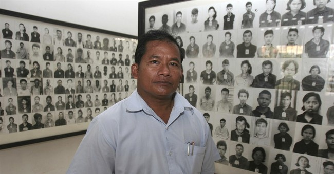 Photographer at Khmer Rouge torture center enters politics