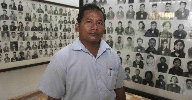 Photographer at Khmer Rouge torture center enters politics