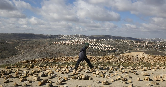 Israel evacuates West Bank outpost amid new settlement binge