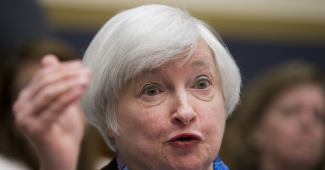 Fed leaves rates alone and gives no hint of when it may hike