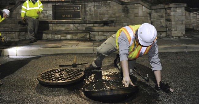 The Latest: Pittsburgh to open hydrants to flush system