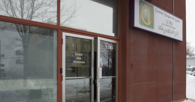 Blood-spattered Quebec mosque opens doors after shooting