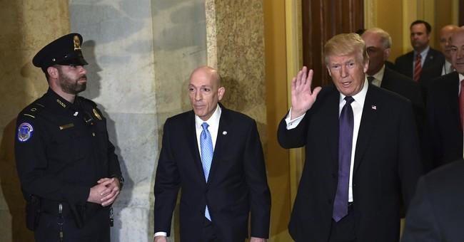 The Latest: Senate panel approves tax overhaul bill
