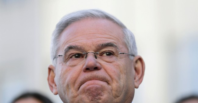 Menendez avoids 'political grave,' but cloud still looms