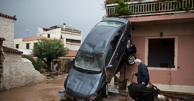 Greeks clean up, mourn after floods kill 16; 4 still missing