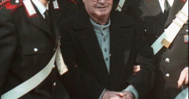 Italian minister OKs family visits for ailing top Mafia boss